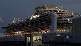 The Diamond Princess cruise ship lies docked at the Daikoku Pier Cruise Terminal in Yokohama, south
