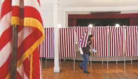 FILE PHOTO: A voter leaves a voting booth after casting her ballot in the state's presidential prima