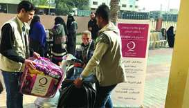 QC delivers winter aid to Palestinian orphans, elderly