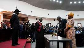 South Sudan's First Vice President Riek Machar takes the oath of office in front of President Salva