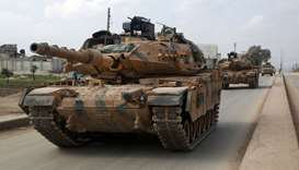 A convoy of Turkish M-60T tanks patrols in the town of Atareb in the rebel-held western countryside