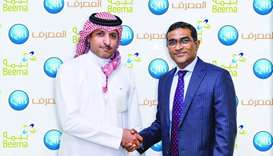 D Anand, QIB's general manager – Personal Banking Group, and Nasser al-Misnad, CEO, Damaan Islamic I