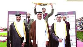 His Highness the Amir Sheikh Tamim bin Hamad al-Thani poses with the winner of the His Highness The