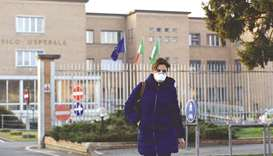 A nurse wearing a protective respiratory mask leaves the municipal hospital in Codogno, southeast of