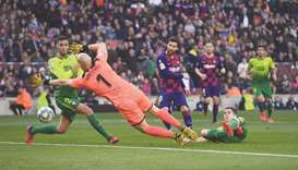 Messi scores four as Barcelona rout Eibar