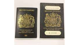 A handout picture released by the UK Home Office press office shows covers of the new blue passport
