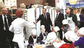 Macron at a cereal sector stand during his visit to the 57th International Agriculture Fair (Salon d