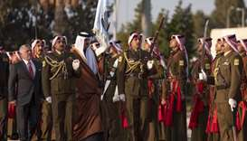 His Highness the Amir Sheikh Tamim bin Hamad Al-Thani inspects a guard of honour accompanied by King
