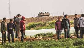Palestinians demonstrate along the Gaza-Israel border east of Khan Yunis in the southern Gaza Strip,