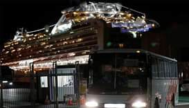 Passengers leave cruise ship Diamond Princess at Daikoku Pier Cruise Terminal in Yokohama