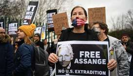 Supporters of WikiLeaks founder Julian Assange,hold placards calling for his freedom outside Woolwic