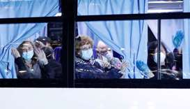 Buses believed to carry the US passengers of the cruise ship Diamond Princess, where dozens of passe