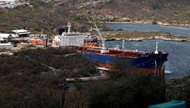A crude oil tanker is docked at Isla Oil Refinery PDVSA terminal