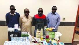 Arrested gang members and the items seized from their residence.