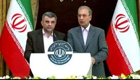 Iran's government spokesman Ali Rabiei (R) and deputy health minister Iraj Harirchi speaking during