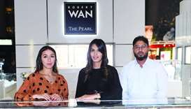 Wafa Habbar (left) and his colleagues at the Robert Wan booth. PICTURES: Shemeer Rasheed