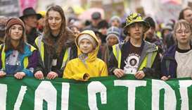 Swedish environmental activist Greta Thunberg and demonstrators attend a youth climate protest in Br