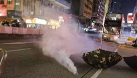 Hong Kong police fire tear gas as black-clad protesters return to streets