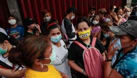 A long queue is formed outside a medical supply store that sells face masks, a day after the Philipp