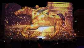 A giant snow sculpture representing the Prix de l'Arc de Triomphe, a horse race