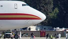 About 350 US evacuees from virus-hit Chinese city land at California air base