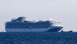 Cruise ship Diamond Princess is seen anchored off the Yokohama Port, after ten people on the cruise