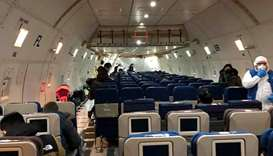 Passengers enter a cargo plane, chartered by the U.S. State Department to evacuate Americans and Can
