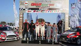 The winners of the Oman International Rally stand on the podium in Muscat