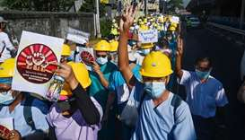 Medical personnel take part in a demonstration against the military coup in Yangon