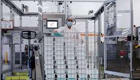 An employee is at work at the factory of British pharmaceutical company GlaxoSmithKline (GSK) in Wav