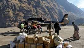 Himalayan helicopter flies flood-hit villagers home to mourn