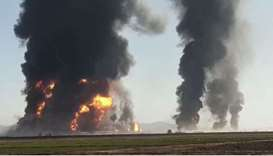 Fire and smoke rise from an explosion of a gas tanker in Herat, Afghanistan in this picture obtained