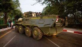 An armoured vehicle is seen on a street during a protest against the military coup, in Yangon, Myanm
