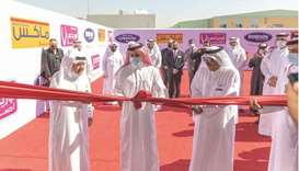 Qatar Chamber chairman Sheikh Khalifa bin Jassim al-Thani (centre) leading the ribbon-cutting ceremo