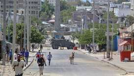 Men flee the site of violent clashes in the Somalian capital, Mogadishu
