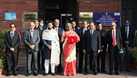 India's Finance Minister Nirmala Sitharaman stands next to Minister of State for Finance and Corpora