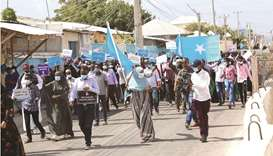 Supporters of different opposition presidential candidates demonstrate in Mogadishu, yesterday.