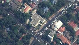 This handout satellite image released by Maxar Technologies shows lines of people outside the Americ