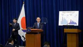Japan's Prime Minister Yoshihide Suga speaks during a news conference on the coronavirus disease (CO