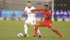 Al Sadd's Santi Cazorla (left) vies for the ball with Al Arabi's Ahmed Fatehi during the QNB Stars L