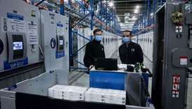 Pfizers employees work at packaging line of the factory of US multinational pharmaceutical company P
