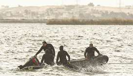 Rescue divers conduct search operations for victims of a capsized boat in Lake Mariout, 20kms west o