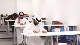 Students at QU campus taking exams by following all the precautions.