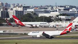 Qantas posts huge loss, says no international flights until October