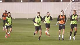 Al Sadd (left) and Al Duhail players train on Thursday on the eve of the Qatar Cup final.