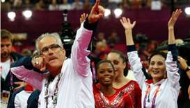 In this file photo taken on July 31, 2012, US women gymnastics team's coach John Geddert celebrates