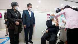 South Korean President Moon Jae-in, watches a doctor receives a shot of AstraZeneca vaccine at a pub