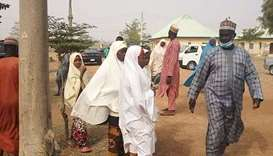 Parents arrive at the school compound, of children kidnapped by bandits, in Jangede, Zamfara State i