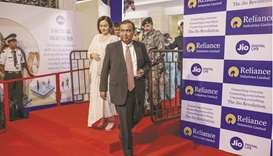 Mukesh Ambani, right, and his wife Nita Ambani arrive for the company's annual general meeting in Mu