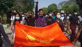 Students from Dagon University take part in a demonstration against the military coup in Yangon, Mya